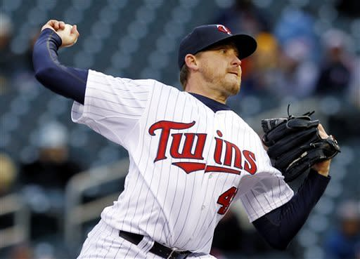 Minnesota Twins starting pitcher Kevin Correia throws against the Los Angeles Angels during the first inning of a baseball game, Monday, April 15, 2013, in Minneapolis. (AP Photo/Genevieve Ross)