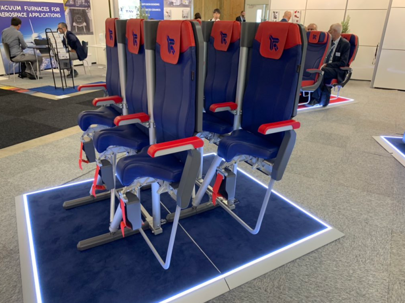A photo of a new stand-up airline seat, the Skyrider 3.0, at the Paris Air Show 2019.