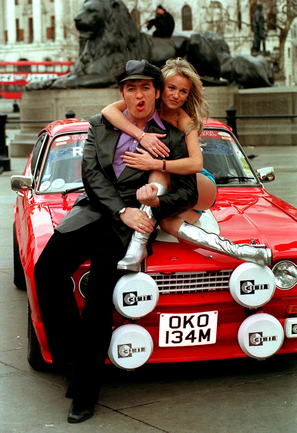 "PA NEWS PHOTO 11/3/98  SHANE Richie AND A FELLOW CAST MEMBER PROMOTE THE NEW MUSICAL ""BOOGIE NIGHTS"" AT A PHOTOCALL IN LONDON'S TRAFALGAR SQUARE.   (Photo by PA Images via Getty Images)"