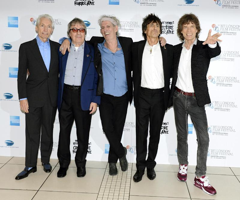 "This Oct. 18, 2012 file photo shows, from left, Charlie Watts, Bill Wyman, Keith Richards, Ronnie Wood and Mick Jagger of The Rolling Stones at London Film Festival American Express Gala for their film, ""The Rolling Stones - Crossfire Hurricane"" at Odeon West End  in London. The archetypal rock 'n' roll band is set for five concerts in London and the New York area over the next month, released another hits compilation with two new songs on Tuesday, Nov. 13, and will see HBO premiere a documentary on their formative years, ""Crossfire Hurricane,"" on Thursday Nov. 15. Wyman was a member of the band until 1993.  (Photo by Jon Furniss/Invision/AP, file)"