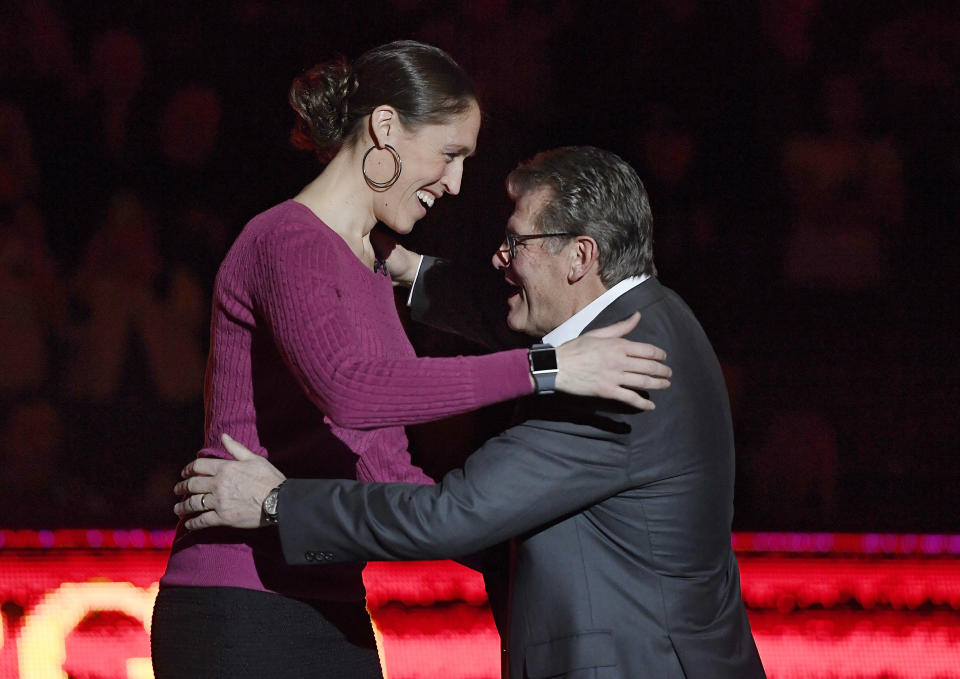 Connecticut head coach Geno Auriemma embraces former player Rebecca Lobo during ceremony retiring Lobo's number during an NCAA college basketball game between Connecticut and Houston, Saturday, March 2, 2019, in Storrs, Conn. (AP Photo/Jessica Hill)