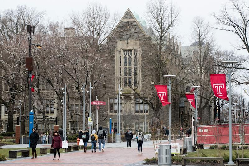 People walk on the Temple University campus in Philadelphia on Friday. Philadelphia health officials say scores of people have contracted mumps at the school. (Photo: ASSOCIATED PRESS)