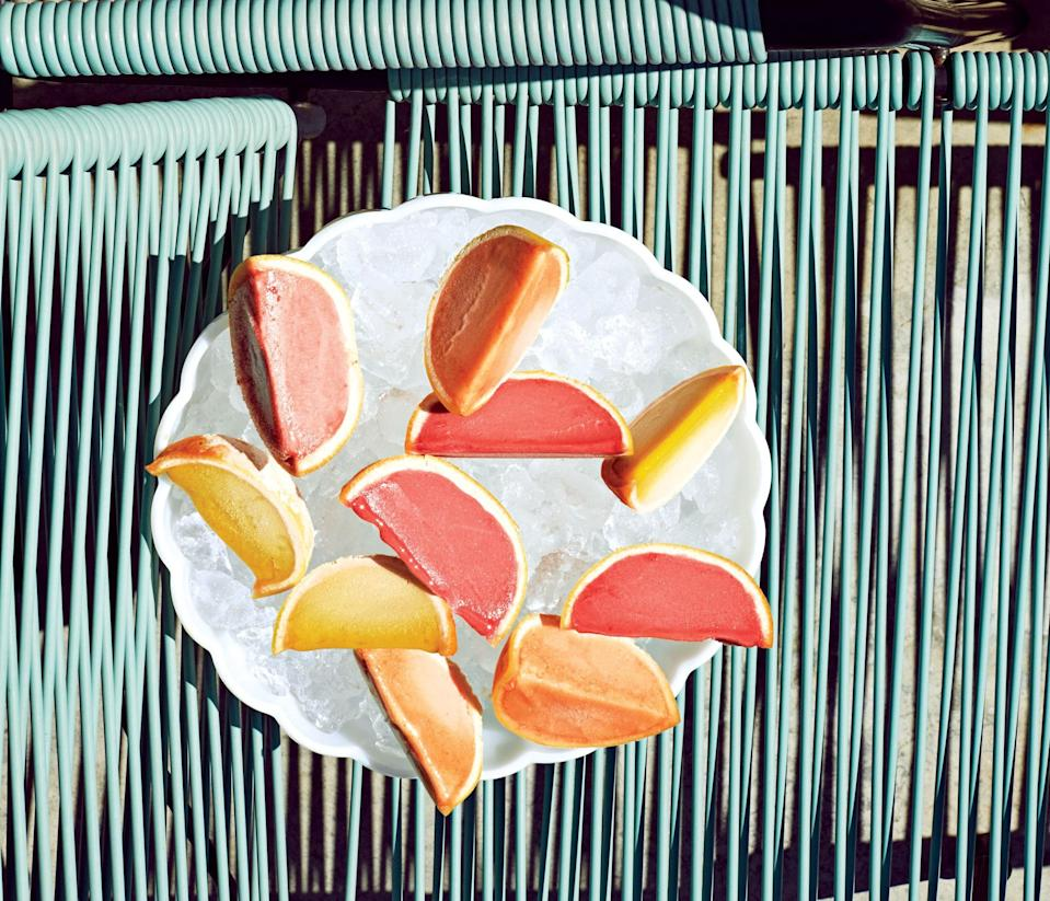 """These frozen treats are also super cute made with orange rinds and work with any flavor sorbet or sherbet you fancy. <a href=""""https://www.bonappetit.com/recipe/sorbet-in-grapefruit-cups?mbid=synd_yahoo_rss"""" rel=""""nofollow noopener"""" target=""""_blank"""" data-ylk=""""slk:See recipe."""" class=""""link rapid-noclick-resp"""">See recipe.</a>"""