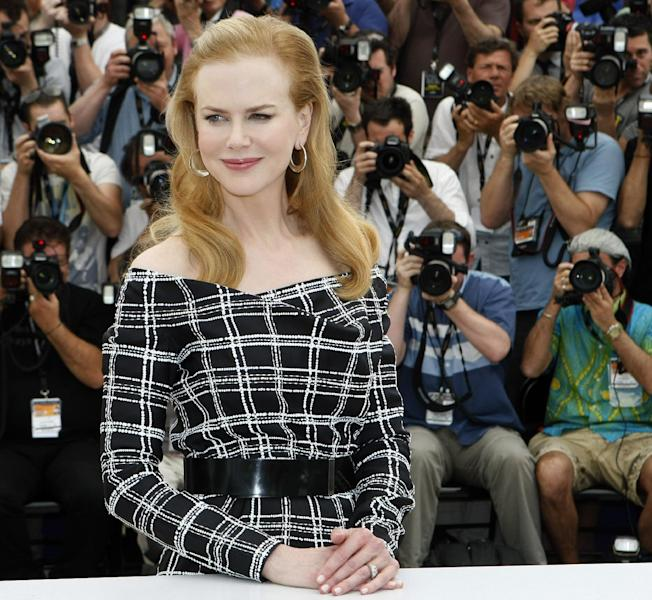 """FILE - In this May 25, 2012 file photo, actress Nicole Kidman poses for photographers during a photo call for """"Hemingway & Gellhorn"""" at the 65th international film festival, in Cannes, southern France. At the London Olympics, away from the track and field, Hollywood royalty such as Kidman and Brad Pitt and Angelina Jolie will be rubbing shoulders with diplomats and businessmen at the city's glitziest clubs and grandest historic buildings. (AP Photo/Lionel Cironneau, File)"""
