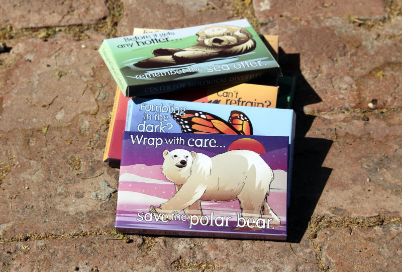 "This undated photo provided by the Center for Biological Diversity in Tucson, Ariz., shows condom packages designed by Lori Lieber from the center's ""Endangered Species Condoms"" series, featuring rhyming maxims and Shawn DiCriscio's illustrations of animal species threatened by population growth. As part of the center's ""Pillow Talk"" program, hundreds of the condoms will be distributed for free during evening Valentine's Day events for adults on Friday, Feb. 9, 2018, at the Carnegie Science Center in Pittsburgh and the San Diego Natural History Museum. (Center for Biological Diversity via AP)"