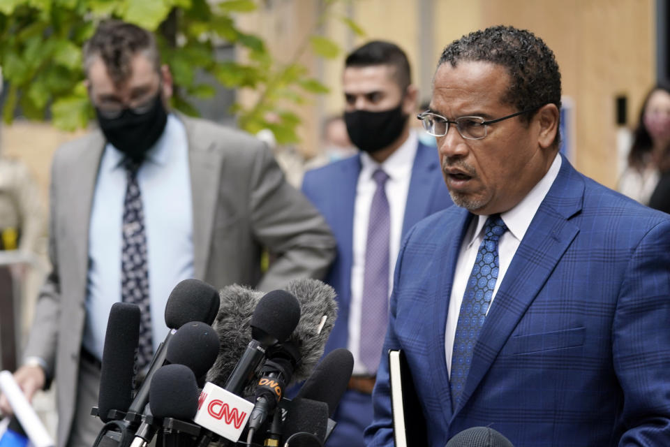 FILE - In this Sept. 11, 2020 file photo, Minnesota Attorney General Keith Ellison, right, addresses reporters outside the Hennepin County Family Justice Center in Minneapolis. Jury selection begins Monday, March 8, 2021, for Derek Chauvin, a former Minneapolis police officer charged with murder and manslaughter in George Floyd's death. Ellison is the lead prosecutor in the case. (AP Photo/Jim Mone, File)
