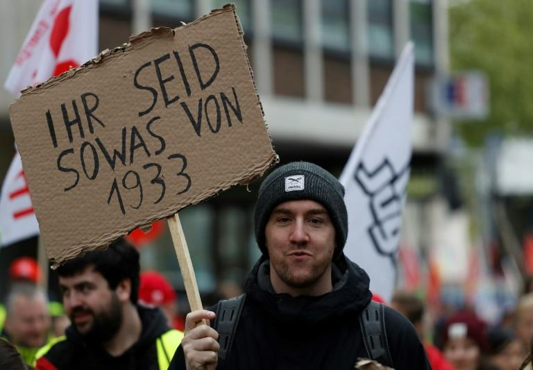 Protesters drew attention to Germany's Nazi past -- this sign reads 'You are so 1933'