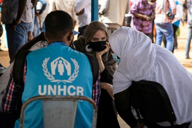 Angelina Jolie speaks with Malian refugees at a camp in Goudebo, in northern Burkina Faso