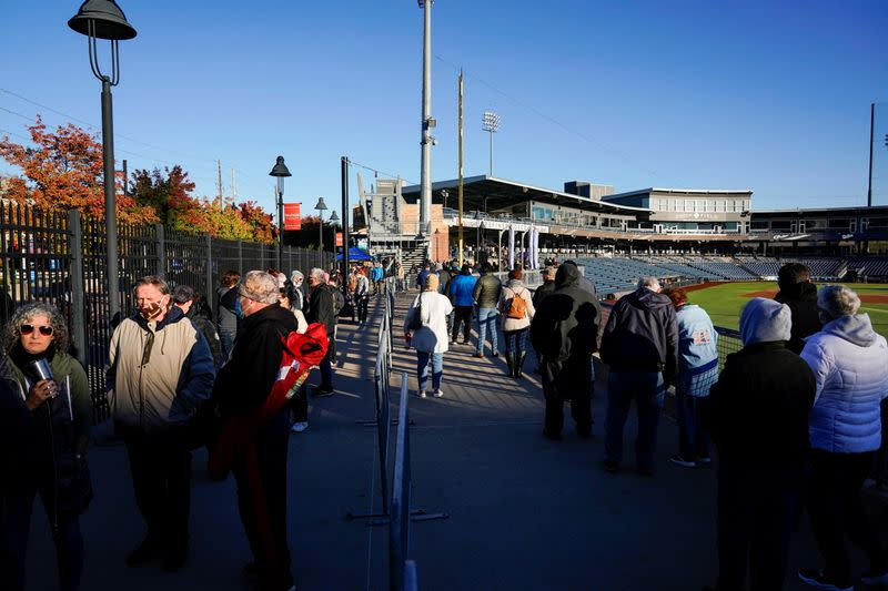 Voters wait in line during early voting at ONEOK Field in Tulsa