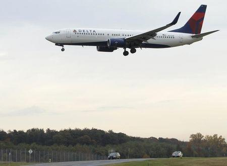 A Delta Air Lines jet lands at BWI Thurgood Marshall International Airport near Baltimore, Maryland