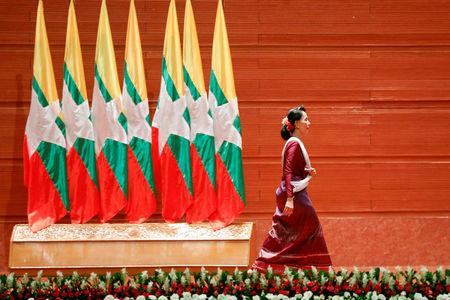 Myanmar State Counselor Aung San Suu Kyi walks off the stage after delivering a speech to the nation over Rakhine and Rohingya situation, in Naypyitaw