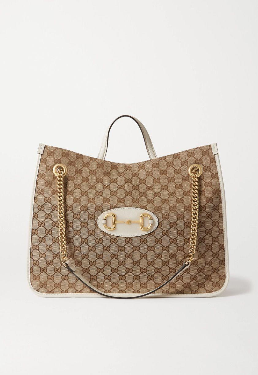 """<p><strong>Gucci </strong></p><p>net-a-porter.com</p><p><strong>$2490.00</strong></p><p><a href=""""https://go.redirectingat.com?id=74968X1596630&url=https%3A%2F%2Fwww.net-a-porter.com%2Fen-us%2Fshop%2Fproduct%2Fgucci%2Fbags%2Ftote-bags%2F1955-horsebit-large-leather-paneled-printed-coated-canvas-tote%2F19325877437137850&sref=https%3A%2F%2Fwww.harpersbazaar.com%2Ffashion%2Ftrends%2Fg22591832%2Fbest-laptop-bags-for-women%2F"""" rel=""""nofollow noopener"""" target=""""_blank"""" data-ylk=""""slk:Shop Now"""" class=""""link rapid-noclick-resp"""">Shop Now</a></p><p>Treat yourself to a luxe tote that will never go out of style. </p>"""
