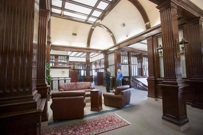Boise developer Ken Howell, right, talks with Christopher Huntley, owner of Huntley Law Firm, which occupied the historic Carnegie Public Library building before it was sold in 2019.