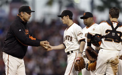 San Francisco Giants manager Bruce Bochy, left, removes pitcher Tim Lincecum from the baseball game against the San Diego Padres in the seventh inning on Saturday, April 20, 2013, in San Francisco. (AP Photo/Ben Margot)