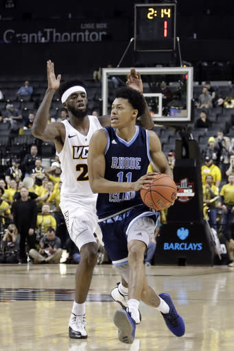 Rhode Island's Jeff Dowtin (11) drives past VCU's Michael Gilmore during the second half of an NCAA college basketball game in the Atlantic 10 men's tournament Friday, March 15, 2019, in New York. Rhode Island won 75-70. (AP Photo/Frank Franklin II)