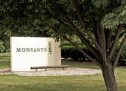 FILE - This June 29, 2006, file photo shows a sign at the Monsanto Co. headquarters in St. Louis. A San Francisco jury on Friday, Aug. 10, 2018, ordered agribusiness giant Monsanto to pay $289 million to a former school groundskeeper dying of cancer, saying the company's popular Roundup weed killer contributed to his disease. (AP Photo/James A. Finley, File)