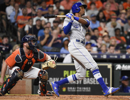 Kansas City Royals' Rosell Herrera watches his RBI triple during the eighth inning of a baseball game against the Houston Astros, Friday, June 22, 2018, in Houston. (AP Photo/Eric Christian Smith)