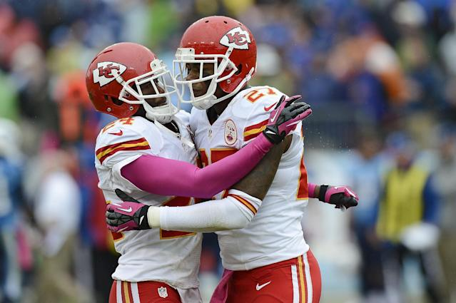 Kansas City Chiefs cornerbacks Brandon Flowers (24) and Sean Smith (27) celebrate after Flowers broke up a pass intended for Tennessee Titans wide receiver Kendall Wright late in the fourth quarter of an NFL football game on Sunday, Oct. 6, 2013, in Nashville, Tenn. Chiefs defensive back Quintin Demps intercepted the deflected pass on the play. (AP Photo/Mark Zaleski)