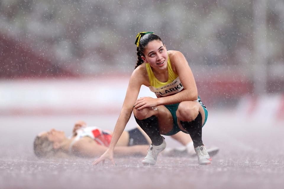Australian Rhiannon Clarke reacts after competing in the 400m in the rain at the Tokyo Paralympics.