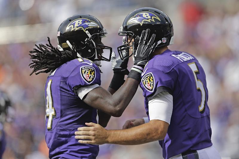 Baltimore Ravens wide receiver Marlon Brown, left, celebrates his touchdown with quarterback Joe Flacco, right, during the second half of an NFL football game against the Cleveland Browns in Baltimore, Md., Sunday, Sept. 15, 2013. (AP Photo/Patrick Semansky)