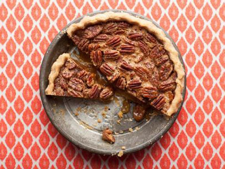 """<p>Crunchy and sweet, Ree Drummond suggests making this simple pie all year-round. Her perfect crust secret? A little distilled white vinegar in the crust. <a href=""""http://www.foodnetwork.com/recipes/ree-drummond/pecan-pie-recipe.html?oc=PTNR-YahooFood-thanksgiving_on_yahoo"""" rel=""""nofollow noopener"""" target=""""_blank"""" data-ylk=""""slk:Get The Pioneer Woman's Pecan Pie recipe at FoodNetwork.com"""" class=""""link rapid-noclick-resp""""><b>Get The Pioneer Woman's Pecan Pie recipe at FoodNetwork.com</b></a> (<i>Photo: Food Network)</i><br></p>"""