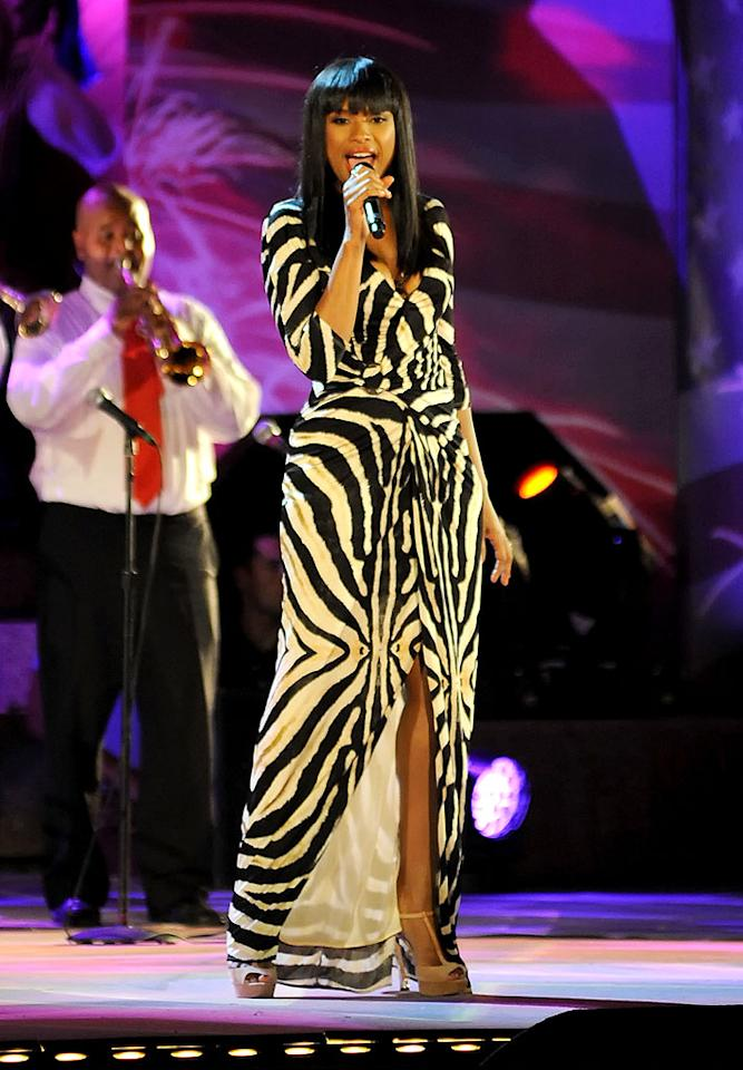 "Jennifer Hudson has been on an inspirational weight loss journey for nearly two years and, needless to say, her determination has paid off. Wearing a zebra-print Roberto Cavalli gown, the multi-talented entertainer looked better than ever last week when she hit the stage to perform alongside the Boston Pops. Nude peep-toe sandals, blunt bangs, and barely-there makeup completed JHud's flawless ensemble. (7/3/2012)<br><br><a target=""_blank"" href=""http://bit.ly/lifeontheMlist"">Follow 2 Hot 2 Handle creator, Matt Whitfield, on Twitter!</a>"
