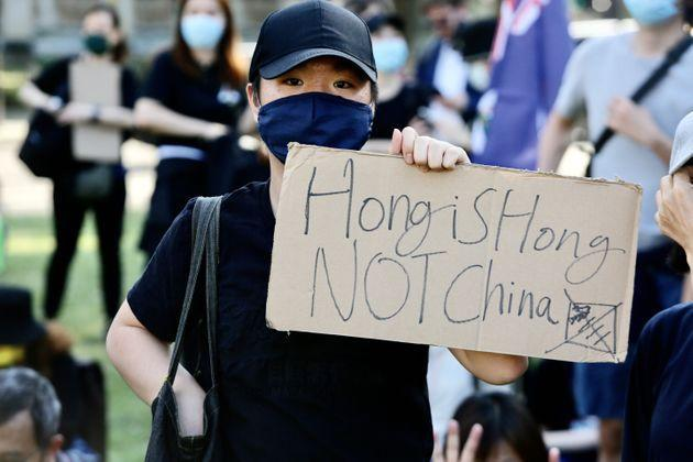 LONDON, UNITED KINGDOM - JUNE 12: People gather at Parliament Square during a rally in support of Hong Kong and against China on the 2nd anniversary of the June 12 Hong Kong protest in London, United Kingdom on June 12, 2021. (Photo by Hasan Esen/Anadolu Agency via Getty Images) (Photo: Anadolu Agency via Anadolu Agency via Getty Images)