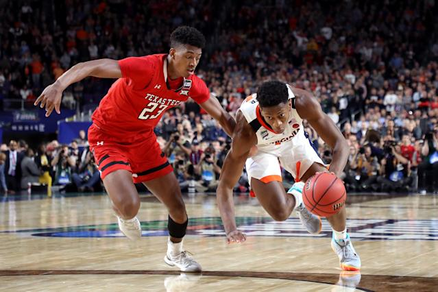 De'Andre Hunter #12 of the Virginia Cavaliers is defended by Jarrett Culver #23 of the Texas Tech Red Raiders during the 2019 NCAA men's Final Four National Championship game at U.S. Bank Stadium on April 08, 2019 in Minneapolis, Minnesota. (Photo by Streeter Lecka/Getty Images)