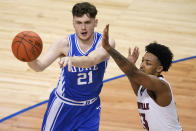 Duke forward Matthew Hurt (21) passes the ball in front of Louisville guard David Johnson (13) during the first half of an NCAA college basketball game in the second round of the Atlantic Coast Conference tournament in Greensboro, N.C., Wednesday, March 10, 2021. (AP Photo/Gerry Broome)