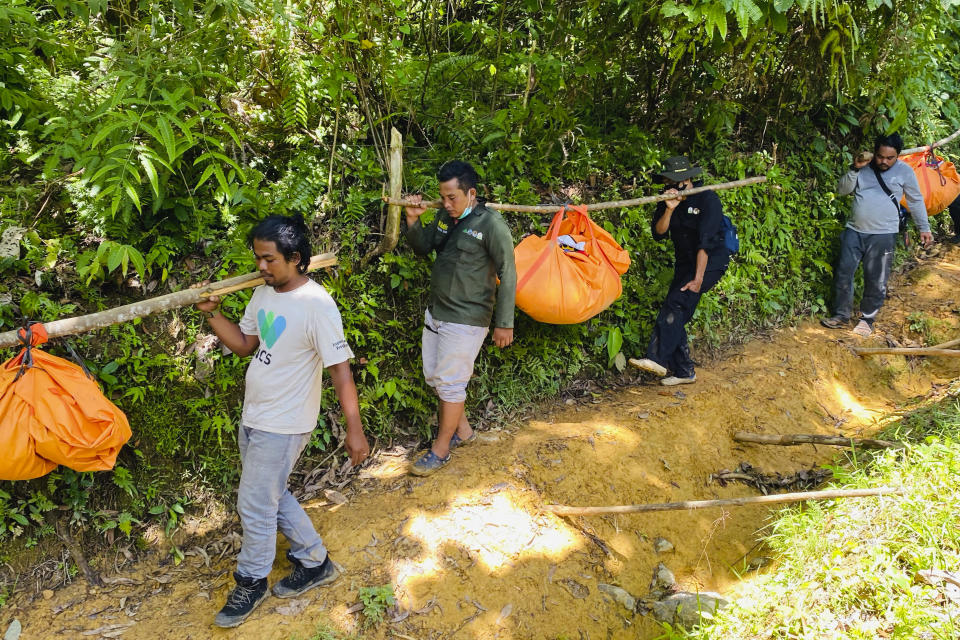 Conservationists carry the carcasses of three Sumatran tigers found dead in Ie Buboh village in South Aceh, Indonesia, Thursday, Aug. 26, 2021. A critically endangered Sumatran tiger and its two cubs were found dead in a conservation area on Sumatra island after being caught in boar traps, in the latest setback to a species whose numbers are estimate to have dwindled to about 400 individuals, authorities said Friday, Aug. 27, 2021. (AP Photo/Tuah Albanna)