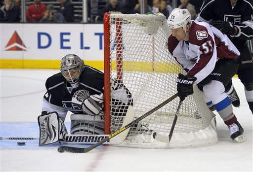 Colorado Avalanche left wing Cody McLeod, right, tries to get a shot in on Los Angeles Kings goalie Jonathan Quick during the first period of their NHL hockey game, Thursday, April 11, 2013, in Los Angeles. (AP Photo/Mark J. Terrill)