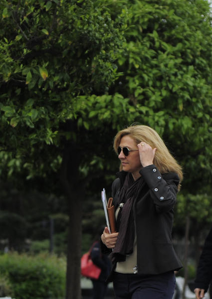 "Spain's Princess Cristina walks toward her office in Barcelona, Spain, Friday, April 5, 2013. Spain's foreign minister said Thursday there was ""enormous concern"" within the government over the naming of one of the king's daughters as a suspect in a corruption case. A Spanish court has named the king's daughter Princess Cristina Wednesday April 3, 2013, as a suspect in an alleged corruption case involving her husband, and the court has announced that it will call her for questioning. (AP Photo/Manu Fernandez)"