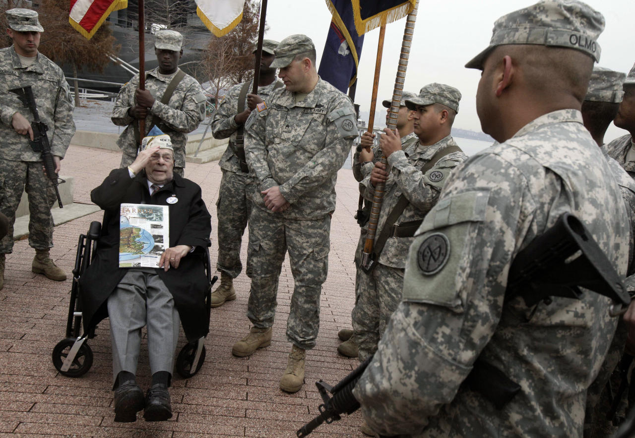 Pearl Harbor survivor Daniel Fruchter, of Eastchester, N.Y., salutes members of a color guard from his wheelchair during a visit at the Intrepid Sea, Air and Space Museum in New York, before ceremonies commemorating the 71st anniversary of the attack at Pearl Harbor, Friday, Dec. 7, 2012. President Barack Obama marked the day on Thursday by issuing a presidential proclamation, calling for flags to fly at half-staff on Friday and asking all Americans to observe the day of remembrance and honor military service members and veterans. (AP Photo/Richard Drew)