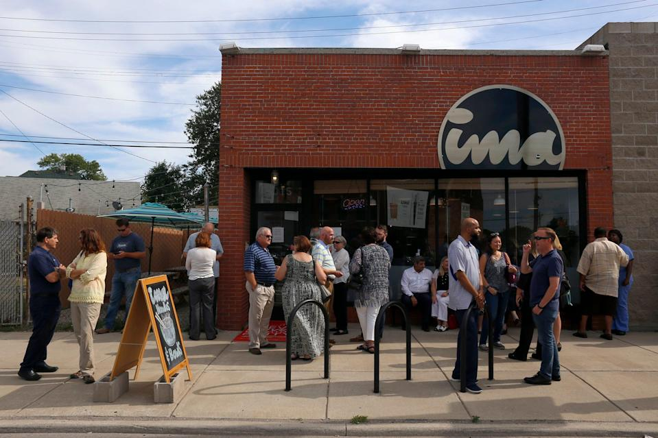 A crowd gathers before the Detroit Free Press/Metro Chevy Dealers Top 10 Takeover of the Ima, on Tuesday, July 27, 2017 in Detroit.
