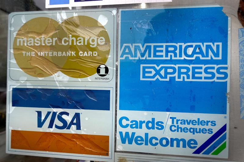 CHICAGO, ILLINOIS - JANUARY 24: A sticker pasted at the entrance of a business lets customers know that they accept American Express credit cards on January 24, 2020 in Chicago, Illinois. American Express today reported better-than-expected fourth-quarter earnings attributed to growing card fee revenues. (Photo by Scott Olson/Getty Images)