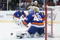 Boston Bruins' Nick Ritchie (21) watches the puck he shot pass New York Islanders goaltender Semyon Varlamov (40) during the first period of Game 4 during an NHL hockey second-round playoff series Saturday, June 5, 2021, in Uniondale, N.Y. (AP Photo/Frank Franklin II)