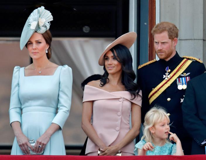 """<div class=""""caption""""> Catherine, Duchess of Cambridge, Meghan, Duchess of Sussex, Prince Harry, Duke of Sussex and Isla Phillips stand on the balcony of Buckingham Palace during Trooping The Colour 2018 on June 9, 2018 in London, England. </div> <cite class=""""credit"""">Max Mumby/Indigo</cite>"""