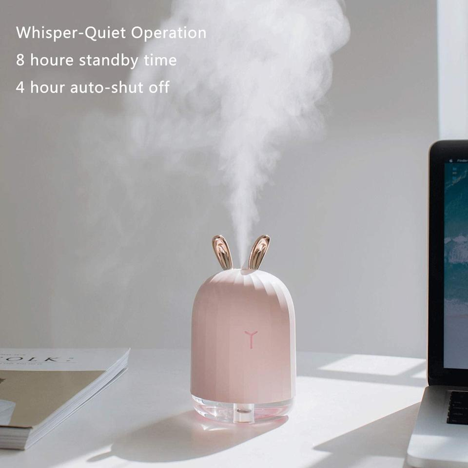 """<h3><a href=""""https://amzn.to/2ohRX7R"""" rel=""""nofollow noopener"""" target=""""_blank"""" data-ylk=""""slk:Warrita Cool Mist Humidifier With Night Light"""" class=""""link rapid-noclick-resp"""">Warrita Cool Mist Humidifier With Night Light</a></h3><br><strong>Super Quiet Desk Humidifier</strong><br><br>This cutie comes with rabbit ears and won't make a peep but it's certainly made a ton of noise with reviewers on Amazon. People praise its adorableness (naturally), problem-solving mist, and easy to assemble features.<br><br><strong>Warrita</strong> Cool Mist Humidifier With Night Light, $, available at <a href=""""https://amzn.to/365NSou"""" rel=""""nofollow noopener"""" target=""""_blank"""" data-ylk=""""slk:Amazon"""" class=""""link rapid-noclick-resp"""">Amazon</a>"""
