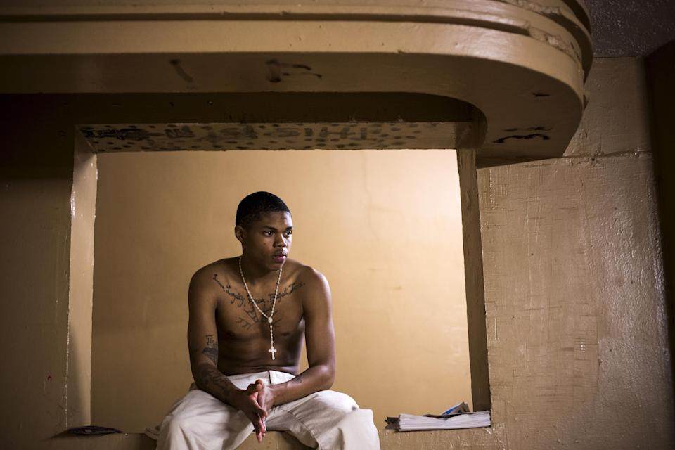 Former Rikers inmate Jared Peartree, 19, poses for a photograph outside his grandmother's house in the Brooklyn borough of New York, October 2, 2014. (REUTERS/Elizabeth Shafiroff)