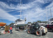A sailboat is moved into the yard after being pulled from the water at the Dartmouth Yacht Club in Dartmouth, N.S., on Monday, Sept. 21, 2020. Hurricane Teddy is expected to impact the Atlantic region starting mid-day Tuesday as a post-tropical storm, bringing rain, wind and high waves. (Andrew Vaughan/The Canadian Press via AP)