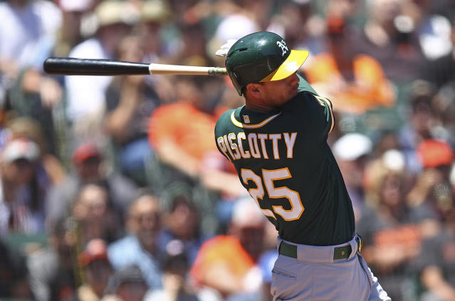 Oakland Athletics' Stephen Piscotty swings for an RBI-single off San Francisco Giants' Andrew Suarez in the fourth inning of a baseball game Sunday, July 15, 2018, in San Francisco. (AP Photo/Ben Margot)