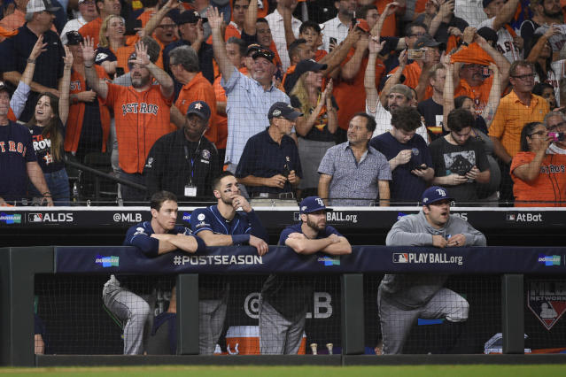 Tampa Bay Rays players watch from the dugout as they lose to the Houston Astros in Game 5 of a baseball American League Division Series in Houston, Thursday, Oct. 10, 2019. (AP Photo/Eric Christian Smith)