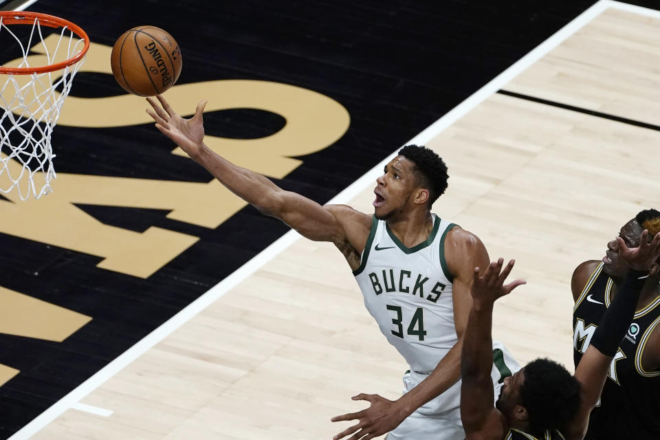 Milwaukee Bucks forward Giannis Antetokounmpo (34) releases a shot against the Atlanta Hawks during the first half of an NBA basketball game Thursday, April 15, 2021, in Atlanta. (AP Photo/John Bazemore)
