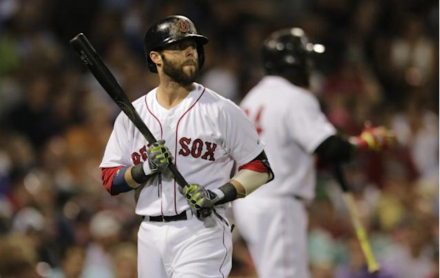 Boston Red Sox's Dustin Pedroia heads back to the dugout after striking out against Chicago Cubs starting pitcher Jake Arrieta during the seventh inning of a baseball game at Fenway Park in Boston, Monday, June 30, 2014. (AP Photo/Charles Krupa)