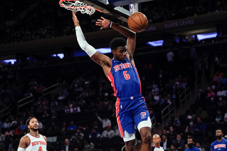 Detroit Pistons' Hamidou Diallo dunks in front of New York Knicks' Derrick Rose during the first half of a preseason NBA basketball game Wednesday, Oct. 13, 2021, in New York.