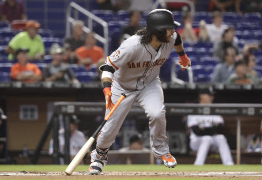 San Francisco Giants' Brandon Crawford watches his RBI groundout during the first inning of the team's baseball game against the Miami Marlins, Tuesday, June 12, 2018, in Miami. (AP Photo/Lynne Sladky)