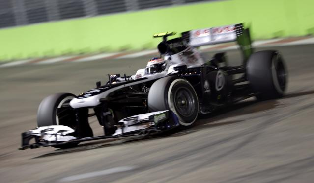 Williams Formula One driver Valtteri Bottas of Finland drives during the second practice session of the Singapore F1 Grand Prix at the Marina Bay street circuit in Singapore September 20, 2013. REUTERS/Tim Chong (SINGAPORE - Tags: SPORT MOTORSPORT F1)