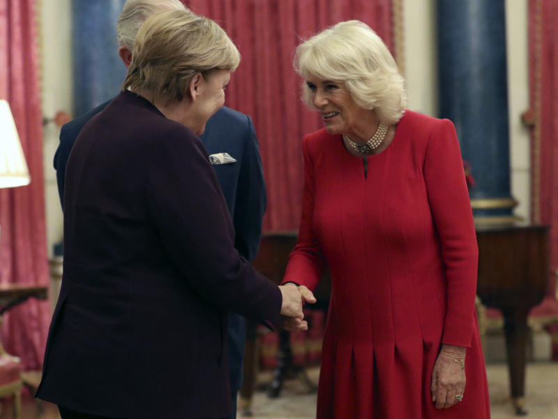 Chancellor of Germany Angela Merkel, talks to Britain's Prince Charles and Camilla, Duchess of Cornwall during a reception at Buckingham Palace, as NATO leaders gather to mark 70 years of the alliance, in London, Tuesday, Dec. 3, 2019. U.S. President Donald Trump and his NATO counterparts were gathering in London Tuesday to mark the alliance's 70th birthday amid deep tensions as spats between leaders expose a lack of unity that risks undermining military organization's credibility. (Yui Mok/Pool Photo via AP)