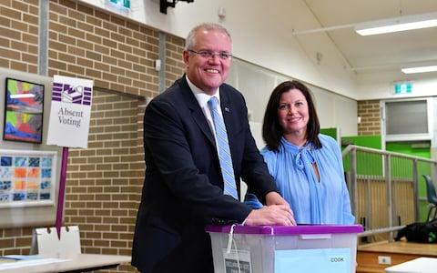 Australian Prime Minister Scott Morrison casts his vote alongside wife Jenny, on Election day, at Lilli Pilli Public School, in Sydney - Credit: STRINGER/ REUTERS