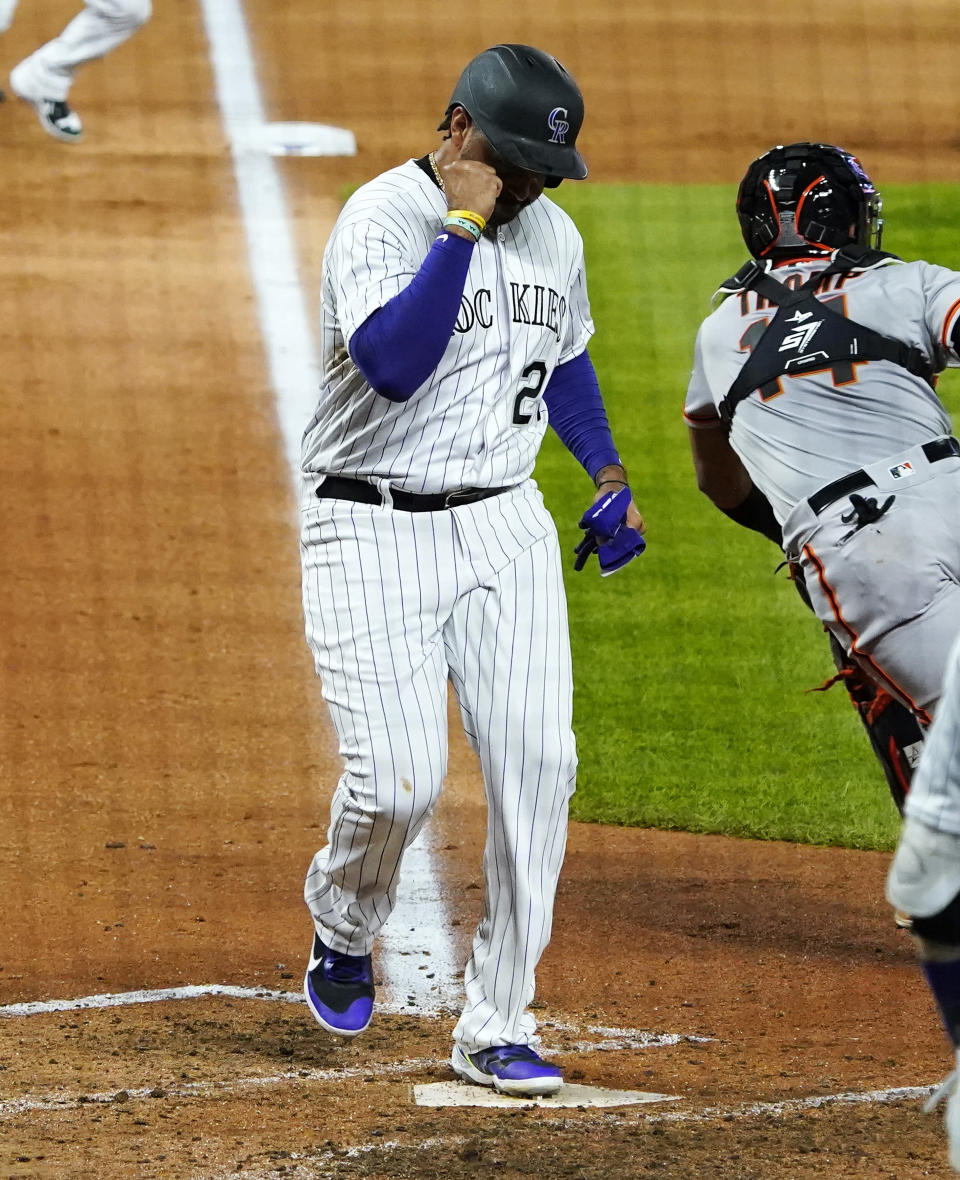 Colorado Rockies' Matt Kemp celebrates a run scored against the San Francisco Giants during the sixth inning of a baseball game, Monday, Aug. 3, 2020, in Denver. (AP Photo/Jack Dempsey)